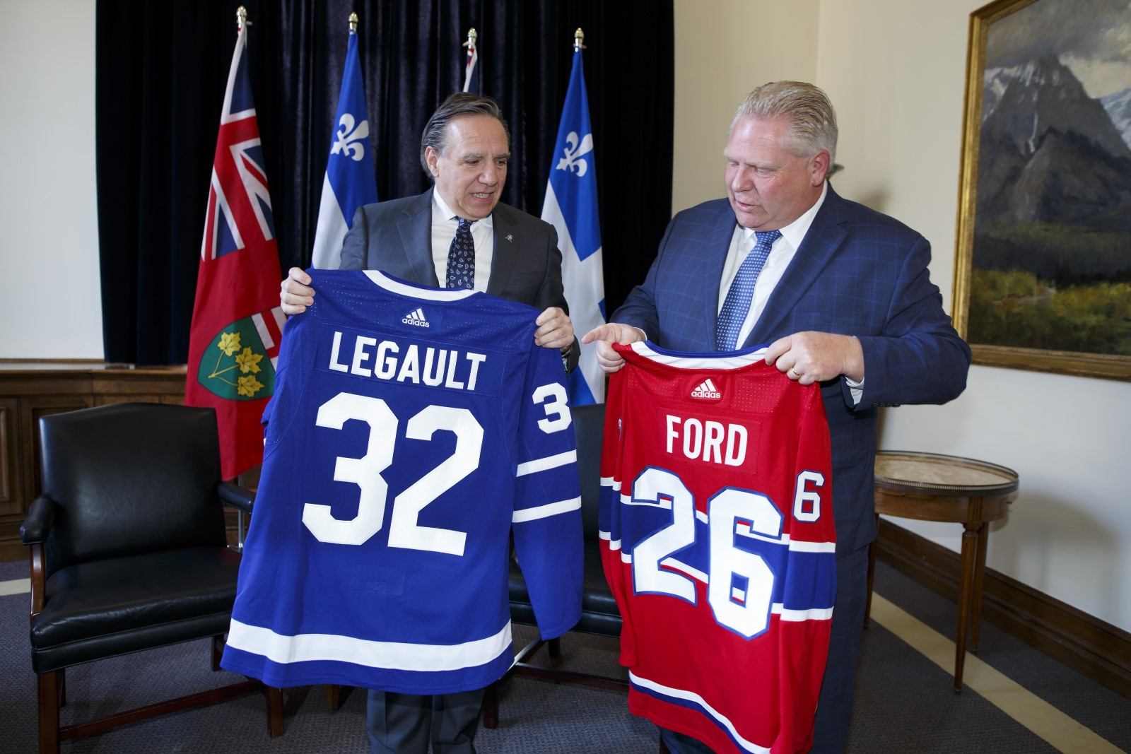 Legault and Ford with matching hockey jerseys