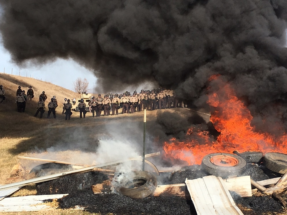 Cops Burning Barricade DAPL