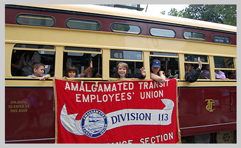 ATU 113 Members holding banner