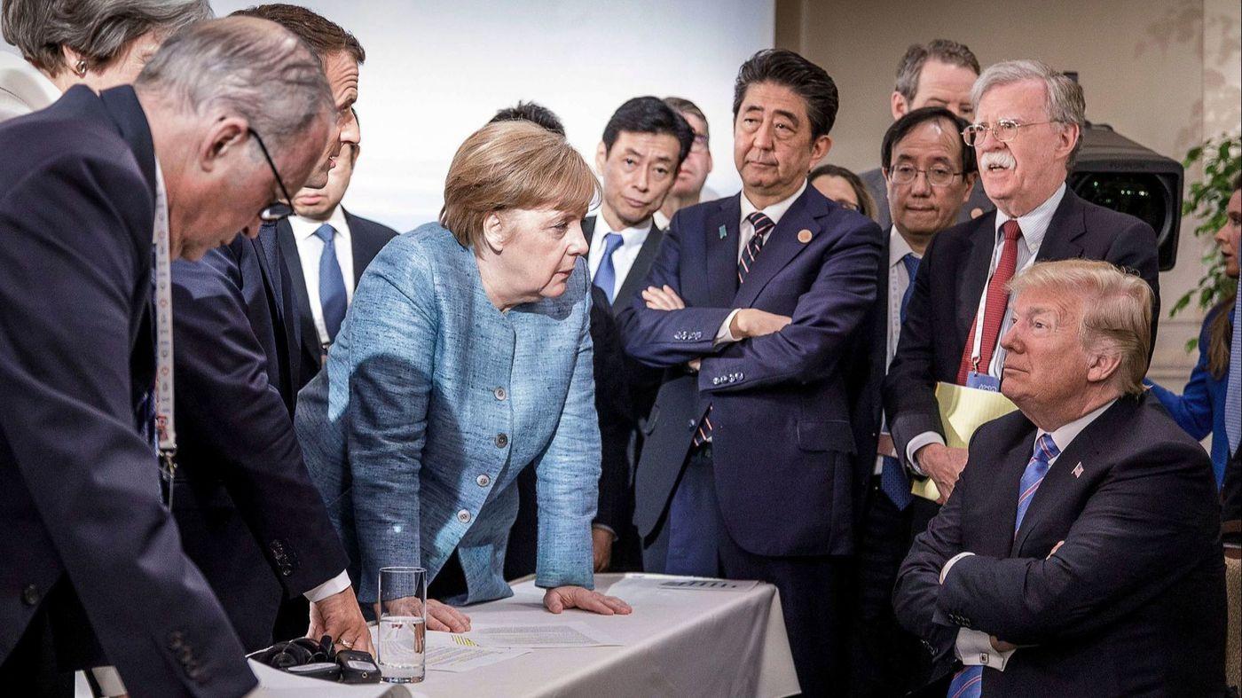 Merkel stares down at Trump