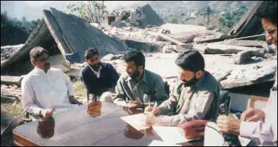 Manzoor Ahmed (left) in Kashmir after the Earthquake