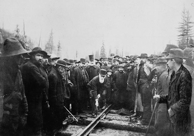 """Hon. Donald A. Smith driving the last spike to complete the Canadian Pacific Railway"", 1885, Library and Archives of Canada"